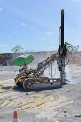 Drilling machine for blasting