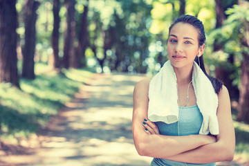 confident fit woman with white towel resting after workout