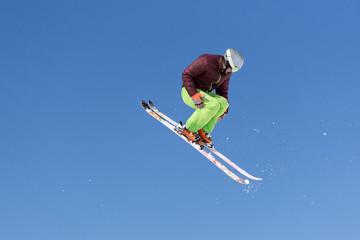 Flying skier on mountains