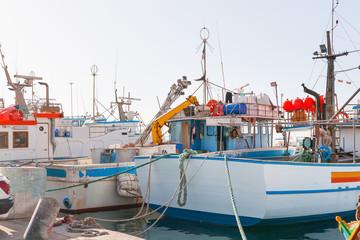 Fisher boats at a pier.Early winter morning in Marsaxlokk, Malta.