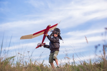 boy with a model airplane field, Young boy-pilot