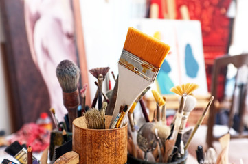 Artist brushes in a studio