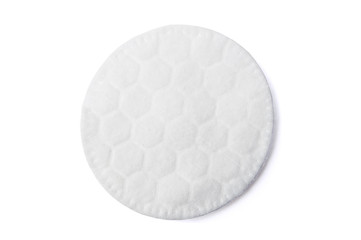 One round cotton cosmetic pad on white