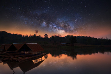 Milky Way and silhouette of hut, Long exposure photograph, with