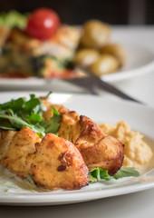 Grilled chicken skewers meal