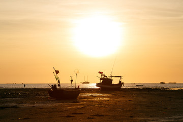 Sunset and siluate boat