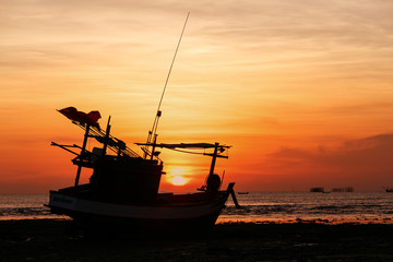 Sunsets and siluate boat