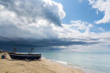 Blue sea and clouds and a boat