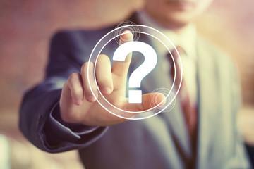 Businessman touch button web question sign