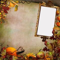 Autumn leaves, berries, vegetables and frame on a green vintage background