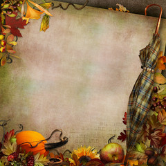 Green vintage background with an umbrella and autumn leaves, berries