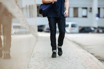 Confident man posing in selvedge  jeans