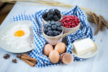 Baking cake in rural kitchen - cake recipe with berries.