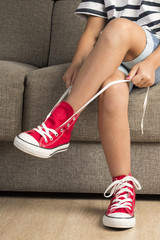 Girl wearing a pair of red sneakers