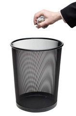Hand Holding Paper over Trash Bin with Clipping Path