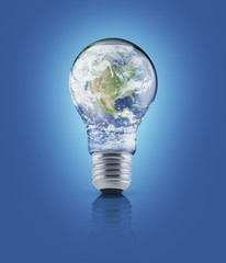 Earth globe in light bulb on blue background, Energy conservatio