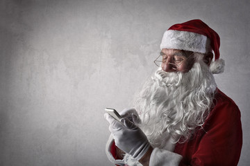 Santa Claus using a smartphone