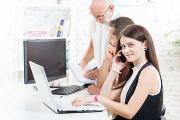 Group business people in office, woman with laptop