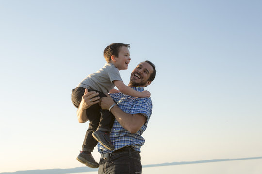 Father with is son at the sunset