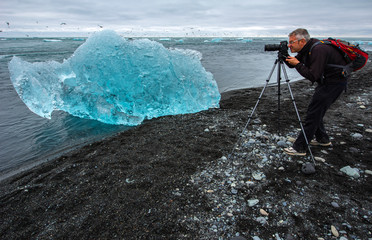 Photographer at Jokulsarlon glacier lagoon, Iceland
