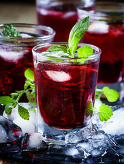 Pomegranate drink with mint and ice, selective focus