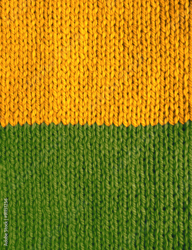 Stocking Stitch Knitting In Yellow And Green Stripes Stock Photo