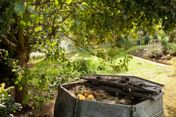 Small outdoor composting bin for recycling kitchen and garden organic waste