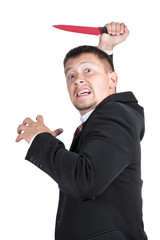 Angry businessman with a knife