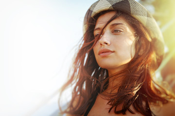 Attractive hipster girl in summer sun light