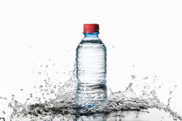Water. Small plastic water bottle with water drops and splash on