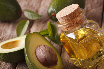 fresh avocado oil in a glass bottle close-up. Horizontal