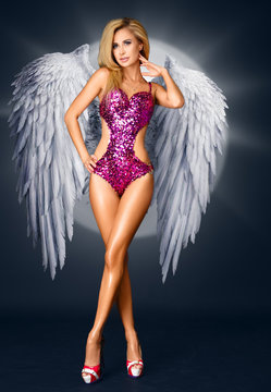sexy girl in a pink bathing suit and white wings. Angel in the style of Victoria's Secret