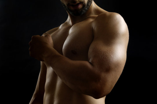 portrait of a man with biceps