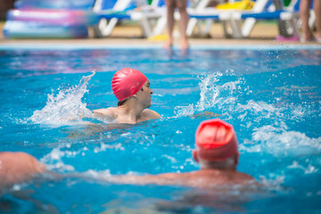 water polo. polo player in a red rubber cap in the pool.