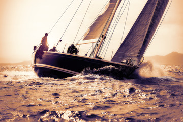 Foto op Aluminium Zeilen sail boat sailing on sunset