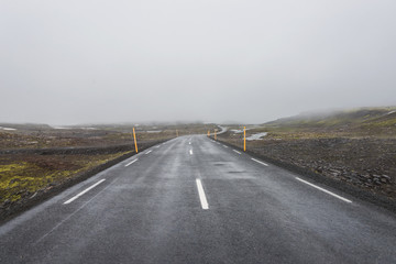 Isolated road and mountain landscape at Iceland, summer time