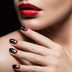 Beautiful girl with  black and red nails. Design manicure