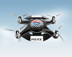 Side view of police drone on blue sky.