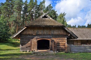 Old Log Shed in forest. Open-air ethnography museum near Riga, Latvia.