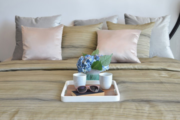 stylish bedroom interior design with decorative tray and pillows