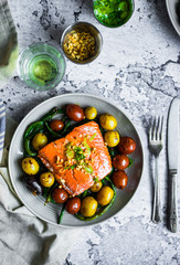 Grilled salmon with beans and potatoes on rustic background