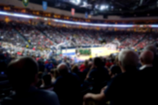 blurred basketball crowd watching game in arena