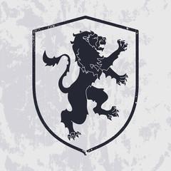 Lion in shield on grunge background - heraldic style