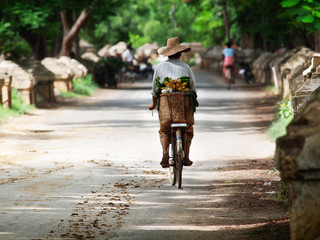 Myanmar, the woman on the bicycle