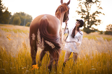 Girl and brown horse