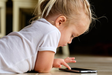 A cute girl playing with a smartphone