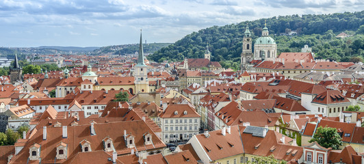 Traditional red roofs in old town of Prague. Touristic destination in Eastern and Central Europe.