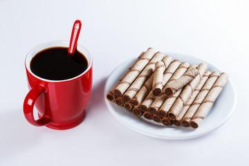 cup of black coffee, cookies, sweet sticks