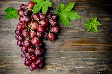Fresh red grape on wooden background