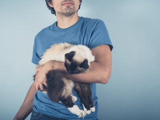 Young man with Birman cat